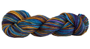 Skein of Manos del Uruguay Silk Blend Space-Dyed DK weight yarn in the color Stellar (Blue) for knitting and crocheting.