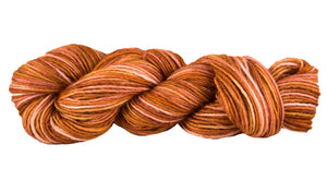 Skein of Manos del Uruguay Silk Blend Space-Dyed DK weight yarn in the color Terra Cotta (Orange) for knitting and crocheting.