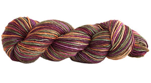 Skein of Manos del Uruguay Silk Blend Space-Dyed DK weight yarn in the color Woodland (Brown) for knitting and crocheting.
