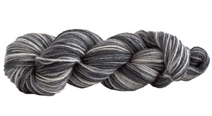 Skein of Manos del Uruguay Silk Blend Space-Dyed DK weight yarn in the color Zebra (Gray) for knitting and crocheting.
