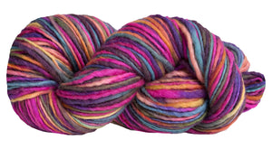 Skein of Manos del Uruguay Wool Clasica Space-Dyed Worsted weight yarn in the color Carnaval (Pink) for knitting and crocheting.