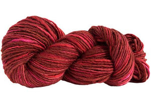 Skein of Manos del Uruguay Wool Clasica Space-Dyed Worsted weight yarn in the color Flame (Red) for knitting and crocheting.