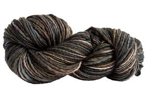 Skein of Manos del Uruguay Wool Clasica Space-Dyed Worsted weight yarn in the color Granite (Black) for knitting and crocheting.