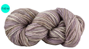 Skein of Manos del Uruguay Wool Clasica Space-Dyed Worsted weight yarn in the color La Perla (Tan) for knitting and crocheting.