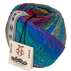 Skein of Noro Ito Worsted weight yarn in the color Yubari (Multi) for knitting and crocheting.