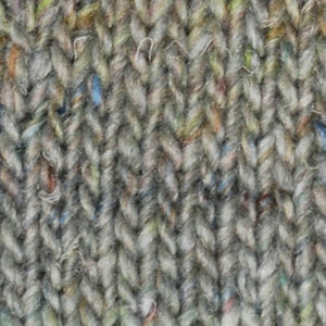 Skein of Noro Silk Garden Sock Solo Sock weight yarn in the color Shiroi (Gray) for knitting and crocheting.