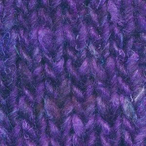 Skein of Noro Silk Garden Sock Solo Sock weight yarn in the color Yanai (Purple) for knitting and crocheting.