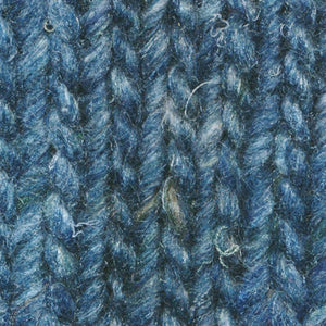 Skein of Noro Silk Garden Solo Worsted weight yarn in the color Suita (Blue) for knitting and crocheting.