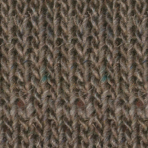 Skein of Noro Silk Garden Solo Worsted weight yarn in color Fujimi (Brown) for knitting and crocheting.