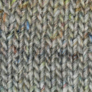 Skein of Noro Silk Garden Solo Worsted weight yarn in color Shiroi (Gray) for knitting and crocheting.