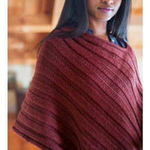 A beautiful poncho knitted with Berroco Vintage yarn. and a pattern from the Olive Poncho Knit Kit.