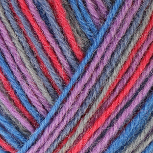 Skein of Regia 4-Ply Kaffe Fassett Design Line Color Sock weight yarn in the color Storm (Multi) for knitting and crocheting.