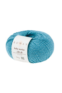 Skein of Rowan Baby Merino Silk DK DK weight yarn in the color Iceberg (Blue) for knitting and crocheting.
