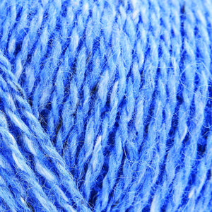 Skein of Rowan Felted Tweed DK DK weight yarn in the color Ciel (Blue) for knitting and crocheting.