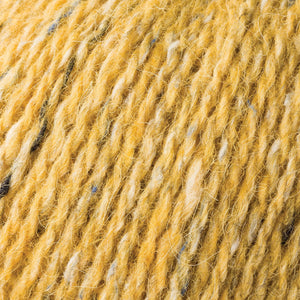 Skein of Rowan Felted Tweed DK DK weight yarn in the color Mineral (Yellow) for knitting and crocheting.