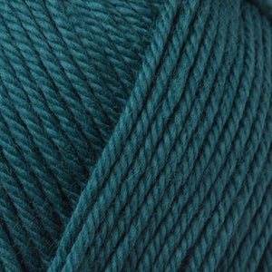 Skein of Rowan Handknit Cotton DK weight yarn in the color North Sea (Blue) for knitting and crocheting.