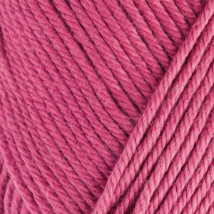 Skein of Rowan Handknit Cotton DK weight yarn in the color Raspberry (Pink) for knitting and crocheting.