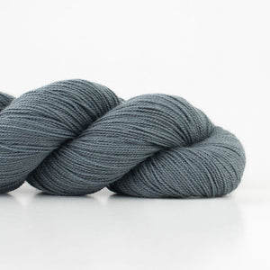 Skein of Shibui Cima Lace weight yarn in the color Graphite (Gray) for knitting and crocheting.