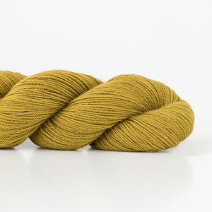Skein of Shibui Cima Lace weight yarn in the color Pollen (Green) for knitting and crocheting.