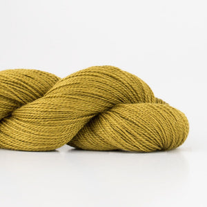 Skein of Shibui Lunar Lace weight yarn in the color Pollen (Green) for knitting and crocheting.