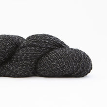 Load image into Gallery viewer, Skein of Shibui Nest DK weight yarn in the color Abyss (Black) for knitting and crocheting.