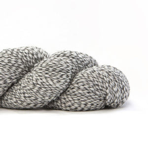 Skein of Shibui Nest DK weight yarn in the color Bone (White) for knitting and crocheting.