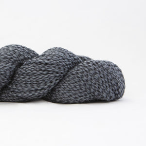 Skein of Shibui Nest DK weight yarn in the color Graphite (Gray) for knitting and crocheting.