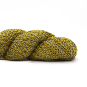 Skein of Shibui Nest DK weight yarn in the color Pollen (Green) for knitting and crocheting.