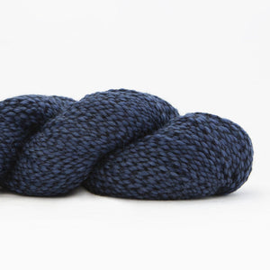 Skein of Shibui Nest DK weight yarn in the color Suit (Blue) for knitting and crocheting.