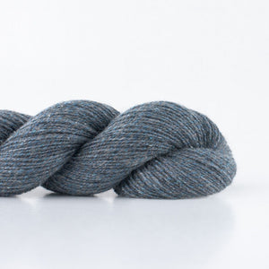 Skein of Shibui Pebble Lace weight yarn in the color Graphite (Gray) for knitting and crocheting.