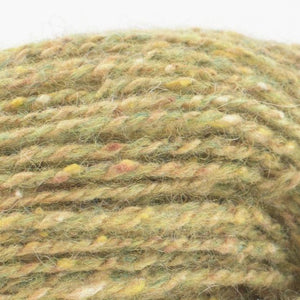 Skein of Shibui Pebble Lace weight yarn in the color Pollen (Green) for knitting and crocheting.