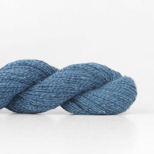 Skein of Shibui Pebble Lace weight yarn in the color Shore (Blue) for knitting and crocheting.