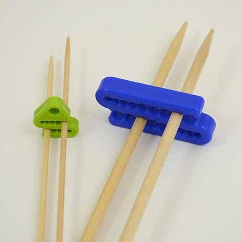 plastic knitting needle holders by the Tempestry Project.