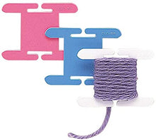 Load image into Gallery viewer, 3 Clover brand knitting bobbins with yarn.