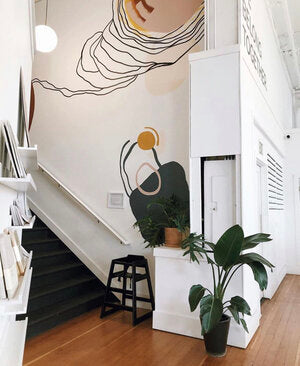large colorful mural in a stairwell with circles and lines