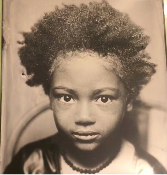 tin type photograph of young child