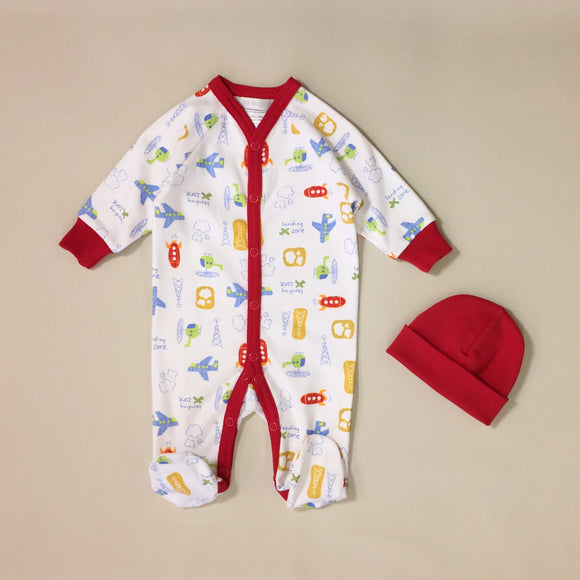 White babygrow with airplane pattern and red stripe with red hat