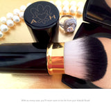 The piano black finish of the Kabuki Brush by Angelina Hart