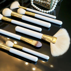 Beautiful pearl white and gold handles of the Angelina Hart professional makeup brush set