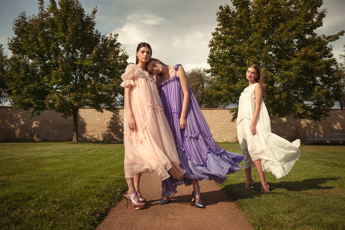 2 GIRLS DRESSED IN SILK ORGANZA, VOILE AND CHIFFON GIRLISH DRESSES FLATTERING IN THE WIND. A KEY VISUAL OF A NEW NANICHE COLLECTION NYMPHAE SS2021