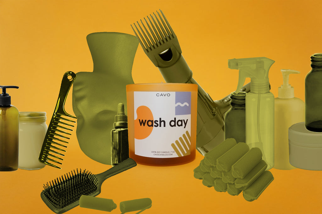 Photo of Wash Day Candle in collage style surrounded by hair product containers, wig head, brushes, spray bottles, blow dryer, etc.