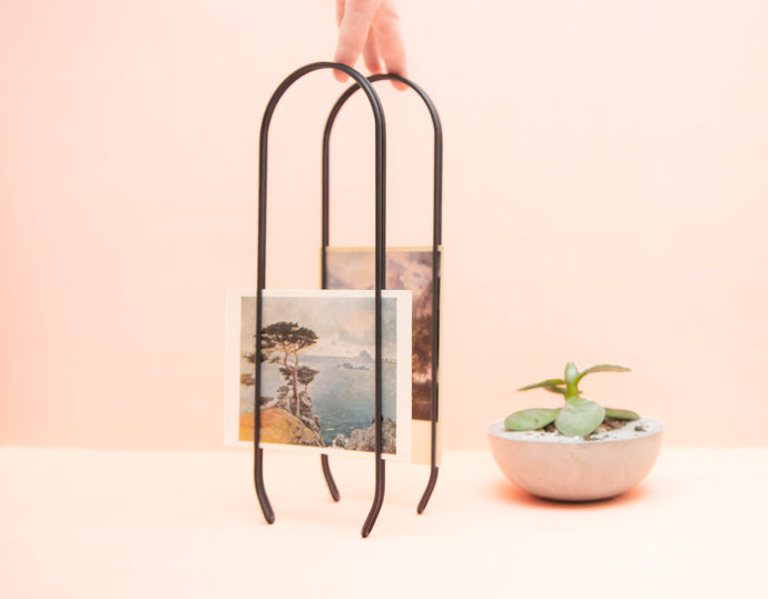 Caliper sustainable modern picture frame. Arch shaped frame, minimal and elegant. Made of recycled steel. Frame and wall display for photographs and art. A unique, zero-waste home interior accent. Elegant, modern black metal home decor.