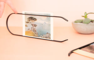 Caliper sustainable modern picture frame. Arch shaped frame, minimal and elegant. Made of recycled steel. Frame and wall display for photographs and art. A unique, zero-waste home interior accent. Elegant, modern home decor.