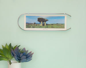 Unique, modern picture frame. The Caliper arch-shaped frame, minimal and elegant. Made of recycled steel. Frame and wall display for photographs and art. A unique, zero-waste home interior accent. Elegant, modern silver metal home decor.