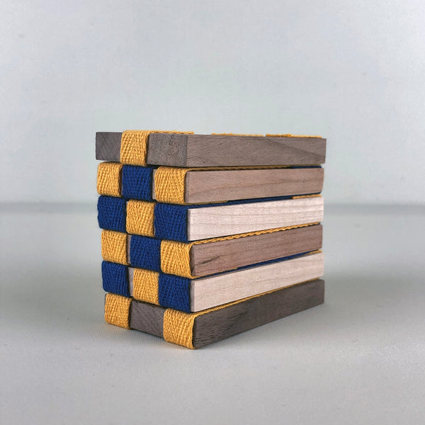 'Never odd or even' Wooden Toy (blue & yellow)