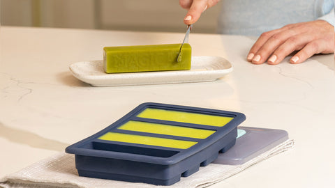 Cutting Into Magical Butter Stick Next to Magical Butter Tray