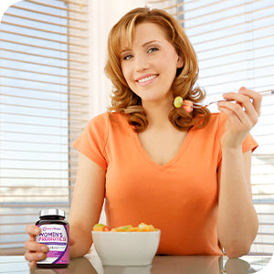 a woman eating light snack with Doctor's Recipes probiotics