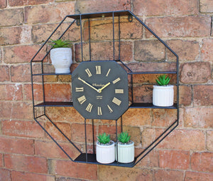 Black metal clock with shelving display