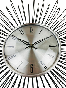 black-wire-looping-wall-clock