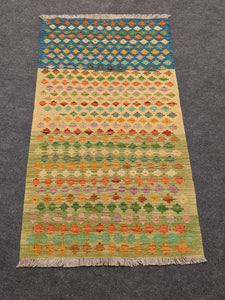Handwoven Wool and Cotton Rug with Flowers - Hittite Home
